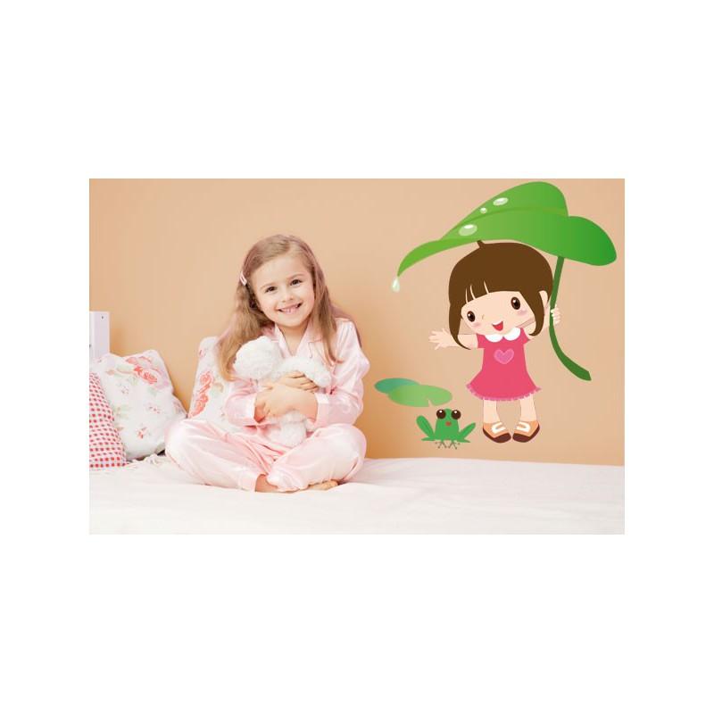 Vinilo infantil de la divertida ni a sujetando una hoja for Vinilos infantiles nina